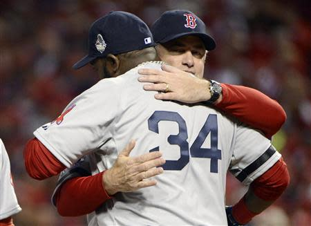 Boston Red Sox designated hitter David Ortiz (34) gets a hug from manager John Farrell before game three of the MLB baseball World Series against the St. Louis Cardinals at Busch Stadium. Mandatory Credit: Eileen Blass-USA TODAY Sports