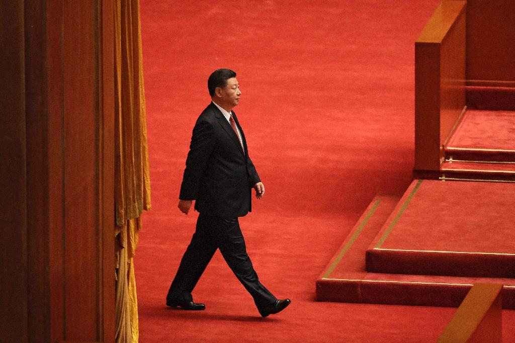 The son of revolutionary hero Xi Zhongxun, China's president Xi Jinping was born in Beijing in 1953 into privilege (AFP Photo/ANDY WONG)