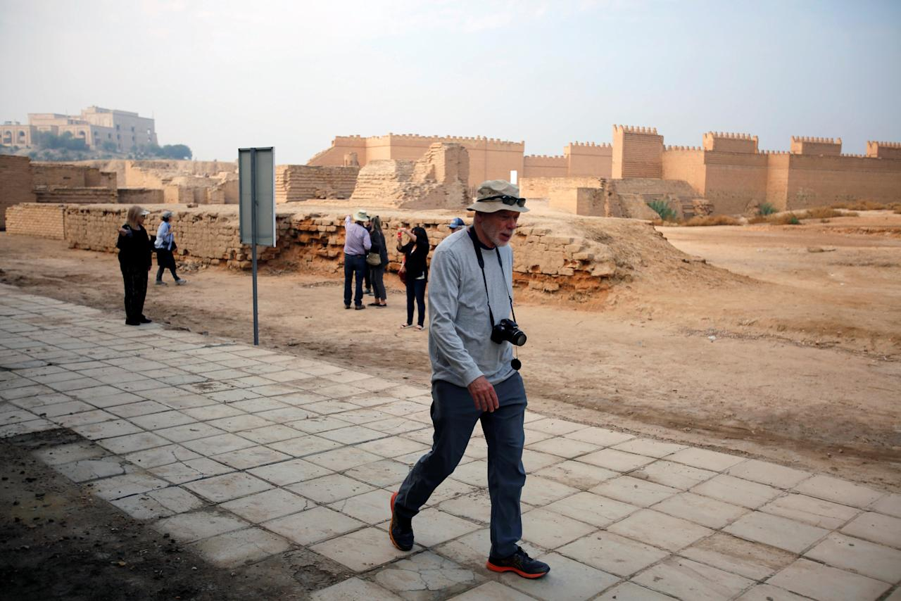 Foreign tourists visit the ancient city of Babylon near Hilla, south of Baghdad, Iraq November 14, 2018. Tourist agencies resumed work after the defeat of the Islamic state in Mosul. Picture taken November 14, 2018. REUTERS/Khalid al-Mousily