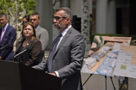 DEA Special Agent in Charge Bill Bodner, center, addresses the media outside the Edward R. Roybal Federal Building, Thursday, May 13, 2021, in Los Angeles. Federal authorities say they have arrested at least 10 suspected drug dealers accused of selling fentanyl and other opioids that led to overdose deaths. (AP Photo/Marcio Jose Sanchez)