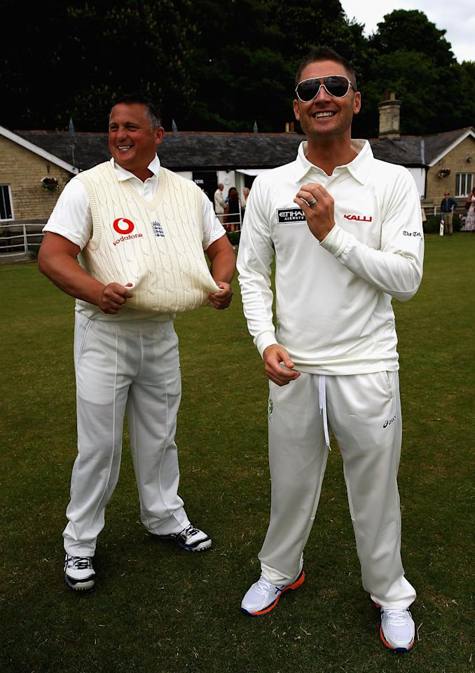 CIRENCESTER, ENGLAND - JUNE 09:  Darren Gough and Michael Clarke talk during the Shane Warne's Australia vs Michael Vaughan's England T20 match at Circenster Cricket Club on June 9, 2013 in Cirencester, England.  (Photo by Matthew Lewis/Getty Images)