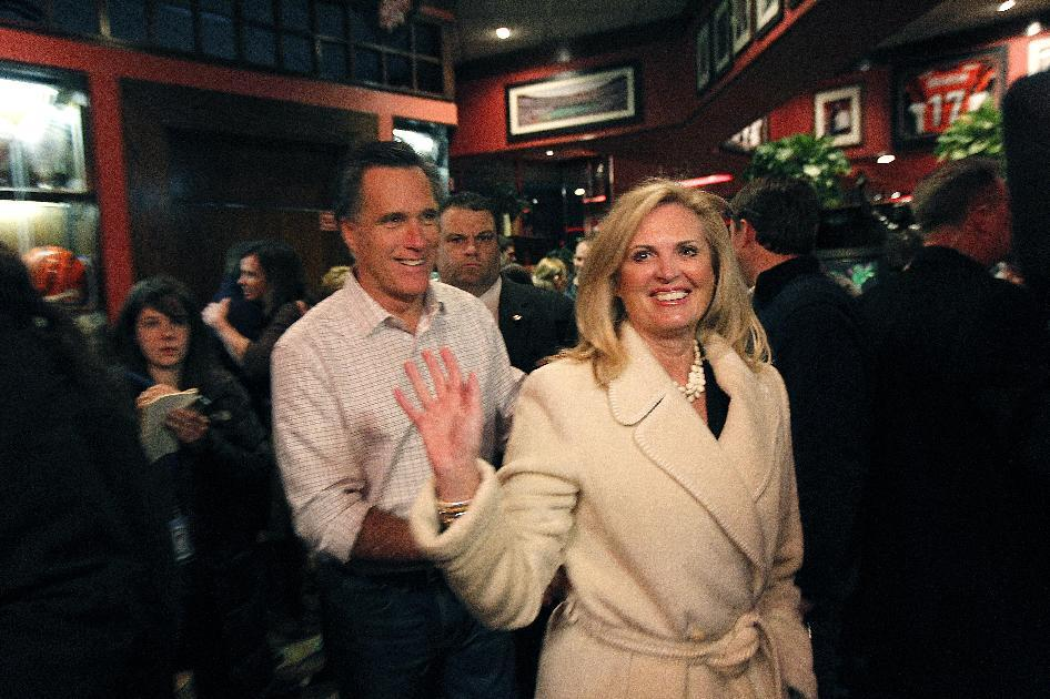 Republican presidential candidate, former Massachusetts Gov. Mitt Romney and his wife Ann greet patrons at the Montgomery Inn in Cincinnati, Ohio, Saturday, March 3, 2012. Mitt Romney stepped out to a solid lead over his Republican presidential rivals Saturday night in Washington state caucuses, a quiet prelude to 10 Super Tuesday contests next week in all regions of the country. (AP Photo/Gerald Herbert)