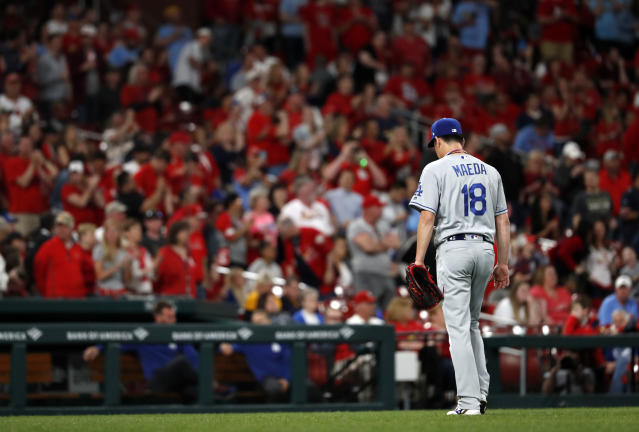 Los Angeles Dodgers starting pitcher Kenta Maeda leaves the baseball game after giving up a two-run home run to St. Louis Cardinals' Yadier Molina during the sixth inning Wednesday, April 10, 2019, in St. Louis. (AP Photo/Jeff Roberson)