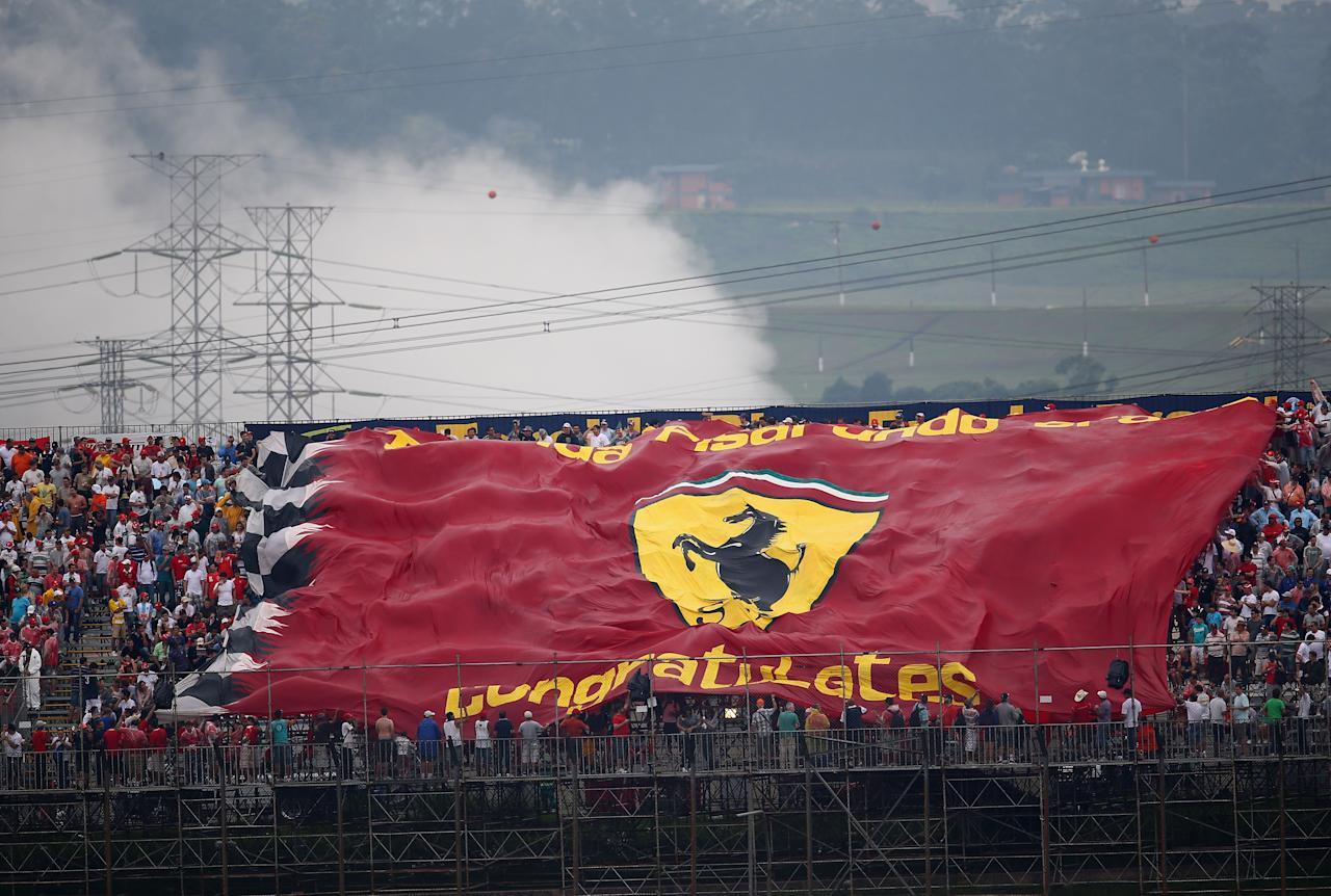 SAO PAULO, BRAZIL - NOVEMBER 24:  Ferrari flag is unfurled during qualifying for the Brazilian Formula One Grand Prix at the Autodromo Jose Carlos Pace on November 24, 2012 in Sao Paulo, Brazil.  (Photo by Clive Mason/Getty Images)