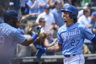 Kansas City Royals' Aldaberto Modesi, right, is congratulated by teammate Hanser Alberto, left, after hitting a home run against the Detroit Tigers during the second inning of a baseball game in Kansas City, Mo., Wednesday, June 16, 2021. (AP Photo/Reed Hoffmann)