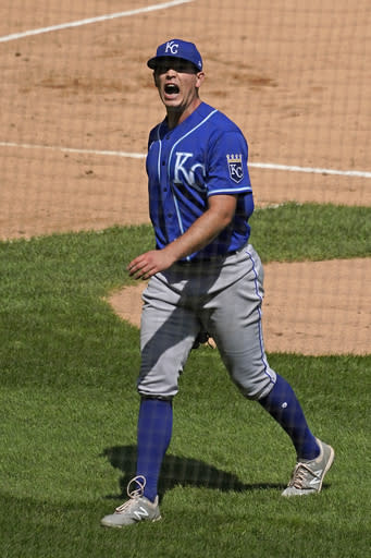 Kansas City Royals starting pitcher Kris Bubic reacts as he walks to the dugout after the third inning of a baseball game against the Chicago White Sox in Chicago, Sunday, Aug. 30, 2020. (AP Photo/Nam Y. Huh)