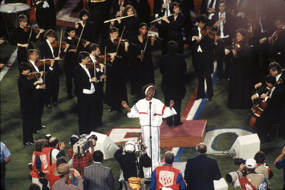 The Florida Symphony Orchestra helped provide the sound behind Whitney Houston at Super Bowl XXV at Tampa Stadium in 1991. (Photo by Gin Ellis/Getty Images)
