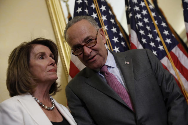Senate Minority Leader Chuck Schumer speaks with House Minority Leader Nancy Pelosi at a news conference about the Child Care for Working Families Act at the U.S. Capitol, Sept. 14, 2017, in Washington, D.C. (Photo: Aaron P. Bernstein/Getty Images)