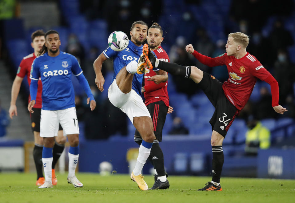 Manchester United's Donny van de Beek (left) in action with Everton's Dominic Calvert-Lewin.