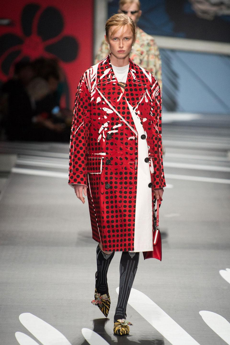 <p>Red and black polka dot patent leather coat from the SS18 Prada collection. (Photo: ImaxTree) </p>