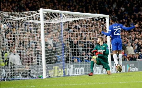 Chelsea's Michy Batshuayi, right, scores - Credit: AP