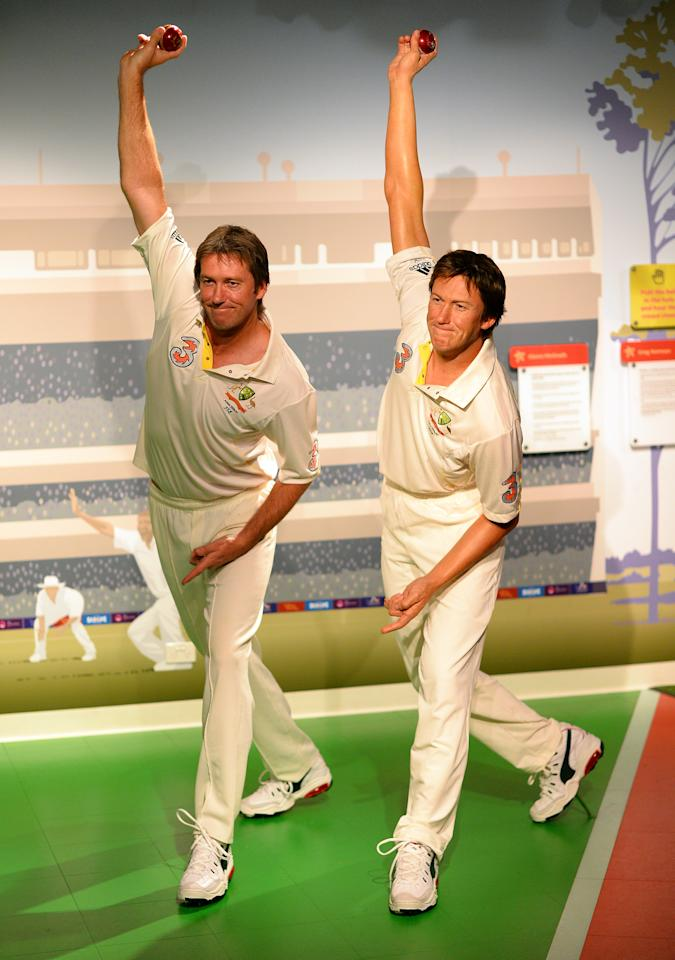 CORRECTION-SPELLING Australia's cricket legend Glenn McGrath (L) poses for photos during the launch of his wax figure at Madame Tussauds in Sydney on July 31, 2013. McGrath was the winner of the Madame Tussauds Sydney Aussie votes campaign where the Australian public was asked to cast their votes on which Australian sporting hero they wanted to see immortalised in wax.     AFP PHOTO / Saeed Khan        (Photo credit should read SAEED KHAN/AFP/Getty Images)
