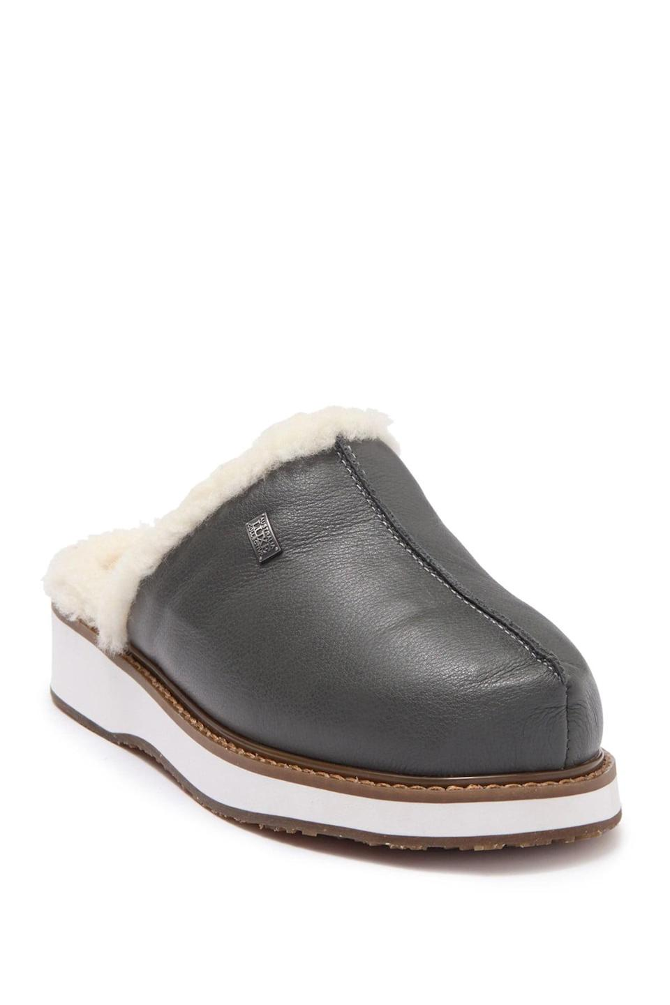 """<h2>Australia Luxe Collective Shearling Supper Mule</h2><br>These smoky gray slip-ons are a luxury-level steal, with a fancy real shearling lining and grippy, logo-ed soles. <br><br><strong>Australia Luxe Collective</strong> Vegan Leather Genuine Shearling Supper Mule, $, available at <a href=""""https://go.skimresources.com/?id=30283X879131&url=https%3A%2F%2Fwww.nordstromrack.com%2Fs%2Faustralia-luxe-collective-vegan-leather-genuine-shearling-supper-mule%2Fn3454458%3Fcolor%3DSMOKE"""" rel=""""nofollow noopener"""" target=""""_blank"""" data-ylk=""""slk:Nordstrom Rack"""" class=""""link rapid-noclick-resp"""">Nordstrom Rack</a>"""