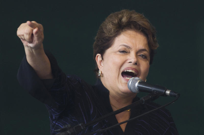FILE - In this Nov. 25, 2011 file photo, Brazil's President Dilma Rousseff speaks at a ceremony to mark the delivery the the first of four ships built for Transpetro, a subsidiary of Brazil's state-run oil company Petrobras, in Niteroi, Brazil. Rousseff has ordered a series of measures aimed to divorce itself from the U.S.-centric Internet and at greater Brazilian online independence and security following revelations that the U.S. National Security Agency intercepted her communications, hacked into the state-owned Petrobras oil company's network and spied on Brazilians who entrust their personal data to U.S. tech companies such as Facebook and Google.(AP Photo/Felipe Dana, File)