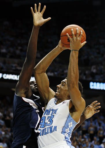 North Carolina's James Michael McAdoo (43) is guarded by Florida Atlantic's Andre Mattison during the second half of an NCAA college basketball game in Chapel Hill, N.C., Sunday, Nov. 11, 2012. North Carolina won 80-56. (AP Photo/Gerry Broome)