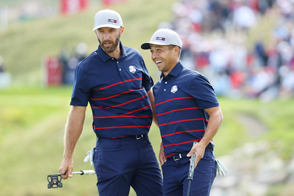 KOHLER, WISCONSIN - SEPTEMBER 24: Dustin Johnson of team United States (L) and Xander Schauffele of team United States react on the seventh green during Friday Afternoon Fourball Matches of the 43rd Ryder Cup at Whistling Straits on September 24, 2021 in Kohler, Wisconsin. (Photo by Andrew Redington/Getty Images)