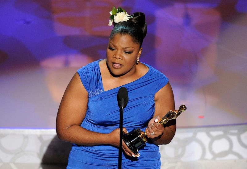 "Mo'Nique accepts the Oscar for best performance by an actress in a supporting role for ""Precious: Based on the Novel 'Push' by Sapphire"" at the 82nd Academy Awards Sunday, March 7, 2010, in the Hollywood section of Los Angeles. (AP Photo/Mark J. Terrill)"
