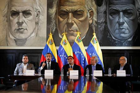 The lawyer Juan Manuel Rafalli (2nd L) speaks, next to the deputies of the Venezuelan coalition of opposition parties (MUD) Eudoro Gonzalez (L) and Juan Miguel Matheus (C), and the lawyers Roman Duque (R) and Eugenio Hernandez-Breton (2nd R), during a news conference in Caracas, Venezuela April 2, 2017. REUTERS/Carlos Garcia Rawlins