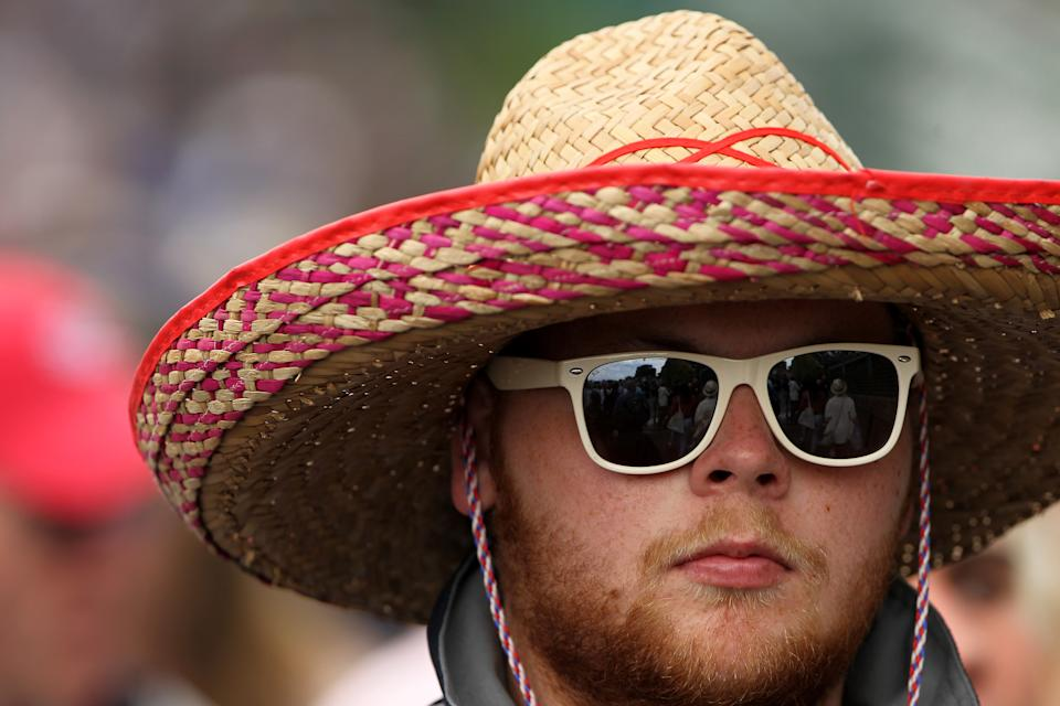 A spectator wears a sombrero as he watches the action on the big screen on day ten of the 2011 Wimbledon Championships at the All England Lawn Tennis and Croquet Club, Wimbledon.   (Photo by Stephen Pond - PA Images via Getty Images)