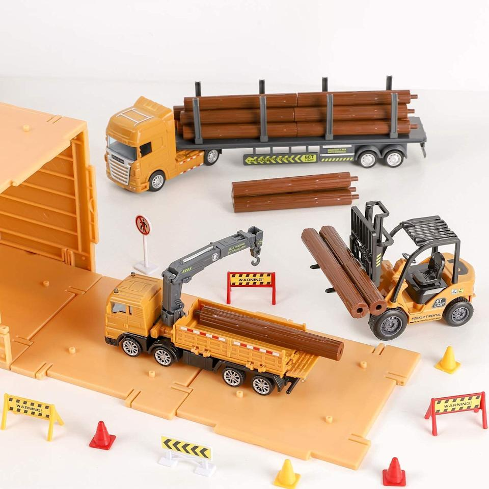 """Itincludes a gantry crane, a pickup truck, a tow truck, a logging truck, a magnetic crane vehicle and forklift as well as a bunch of road signs, barricades, barriers and safety cones. The only question is how much time can this keep the kid occupied for?<br /><br /><strong>Promising review:</strong>""""This set is AWESOME! Our 3-and-a-half-year-old is all about construction, and these had different vehicles than the standard sets. They hold up really well to tough play! It's easy to snap any parts together and place the stickers at the beginning, then he mastered the rest on his own. It has really kept his attention."""" --<a href=""""https://www.amazon.com/dp/B082HDSYR5?tag=huffpost-bfsyndication-20&ascsubtag=5709944%2C16%2C32%2Cd%2C0%2C0%2C0%2C962%3A1%3B901%3A2%3B900%3A2%3B974%3A3%3B975%3A2%3B982%3A2%2C13752223%2C0"""" target=""""_blank"""" rel=""""noopener noreferrer"""">Jelyca</a><br /><br /><strong>Get it from Amazon for <a href=""""https://www.amazon.com/dp/B082HDSYR5?tag=huffpost-bfsyndication-20&ascsubtag=5709944%2C16%2C32%2Cd%2C0%2C0%2C0%2C962%3A1%3B901%3A2%3B900%3A2%3B974%3A3%3B975%3A2%3B982%3A2%2C13752223%2C0"""" target=""""_blank"""" rel=""""noopener noreferrer"""">$31.99</a>.</strong>"""