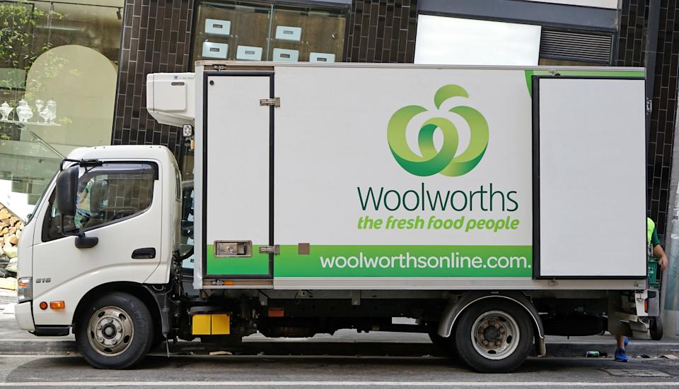 A parked Woolworths delivery truck.