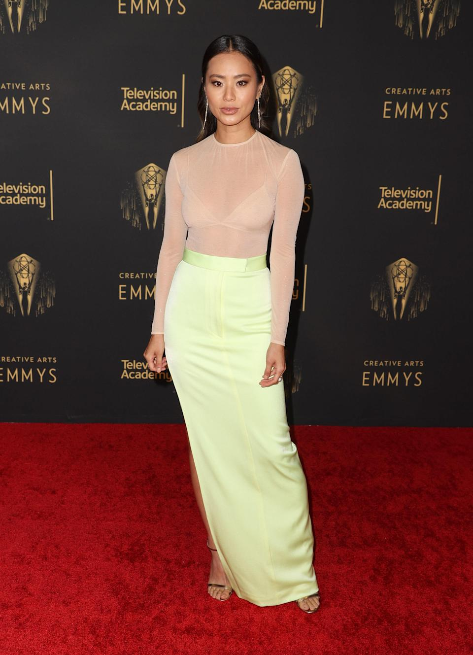 Jamie looked elegant in a sheer nude top, celery green skirt, and super shiny, middle-parted hair.