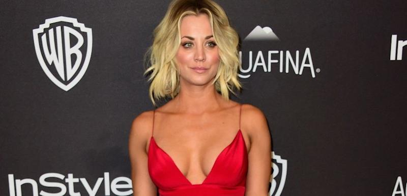 Kaley Cuoco poses at an event