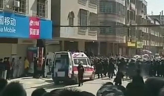 Riot police are deployed in Wenlou, Guangdong province, to quell the protest. Photo: Handout