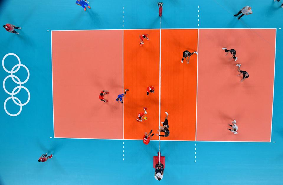 <p>Russia's Igor Kobzar (centre L) prepares to return the ball in the men's quarter-final volleyball match between Canada and Russia during the Tokyo 2020 Olympic Games at Ariake Arena in Tokyo on August 3, 2021. (Photo by Antonin THUILLIER / AFP)</p>