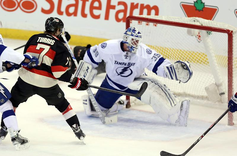 Ottawa Senators' Kyle Turris (7) scores past Tampa Bay Lighting goaltender Anders Lindback during the second period of an NHL hockey game, Thursday, Jan. 30, 2014 in Ottawa, Ontario. (AP Photo/The Canadian Press, Fred Chartrand)