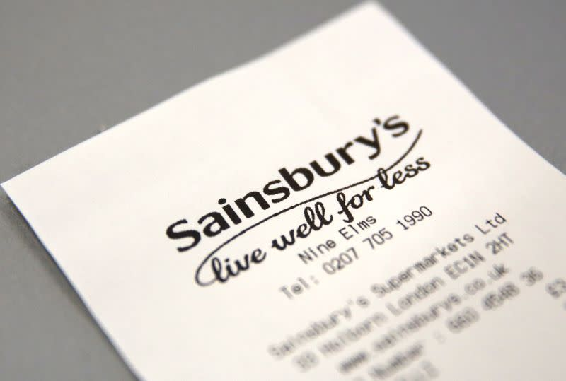FILE PHOTO: A discarded till receipt lies on a table at a Sainsbury's store in London