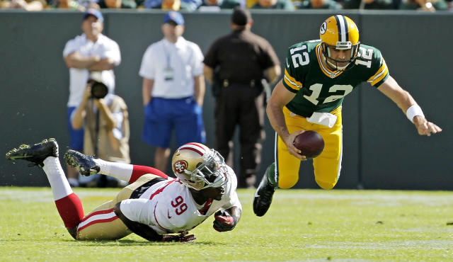 San Francisco 49ers' Aldon Smith (99) sacks Green Bay Packers' Aaron Rodgers (12) during the first half of an NFL football game Sunday, Sept. 9, 2012, in Green Bay, Wis. (AP Photo/Mike Roemer)