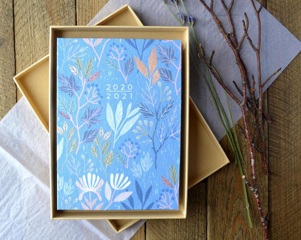 """<h3><a href=""""https://www.etsy.com/listing/826375118/2020-2021-mid-year-planner-academic"""" rel=""""nofollow noopener"""" target=""""_blank"""" data-ylk=""""slk:Claire Tillustration 2020-2021 Mid-Year Planner"""" class=""""link rapid-noclick-resp"""">Claire Tillustration 2020-2021 Mid-Year Planner</a></h3> <br>This mid-year planner was made by hand using eco-friendly recycled papers. Its stunning cover pattern is inspired by seasonal woodland botanicals like autumn leaves and winter berries, and the inside is filled with the space needed to organize all your plans, thoughts, and ideas throughout the year.<br><br><strong>ClaireTIllustration</strong> 2020-2021 Mid-Year Planner, $, available at <a href=""""https://go.skimresources.com/?id=30283X879131&url=https%3A%2F%2Fwww.etsy.com%2Flisting%2F826375118%2F2020-2021-mid-year-planner-academic"""" rel=""""nofollow noopener"""" target=""""_blank"""" data-ylk=""""slk:Etsy"""" class=""""link rapid-noclick-resp"""">Etsy</a><br>"""