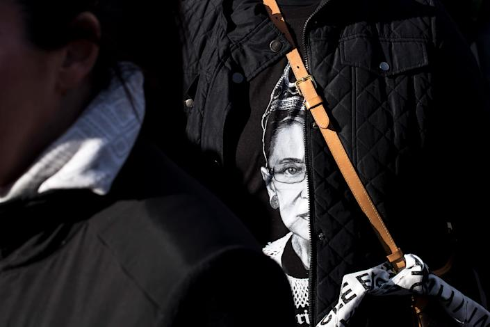 "A woman attending the New York City Women's March wears a t-shirt ​featuring Supreme Court Justic​e Ruth Bader Ginsburg on Jan. 20, 2018. <span class=""copyright"">Karsten Moran—Redux</span>"