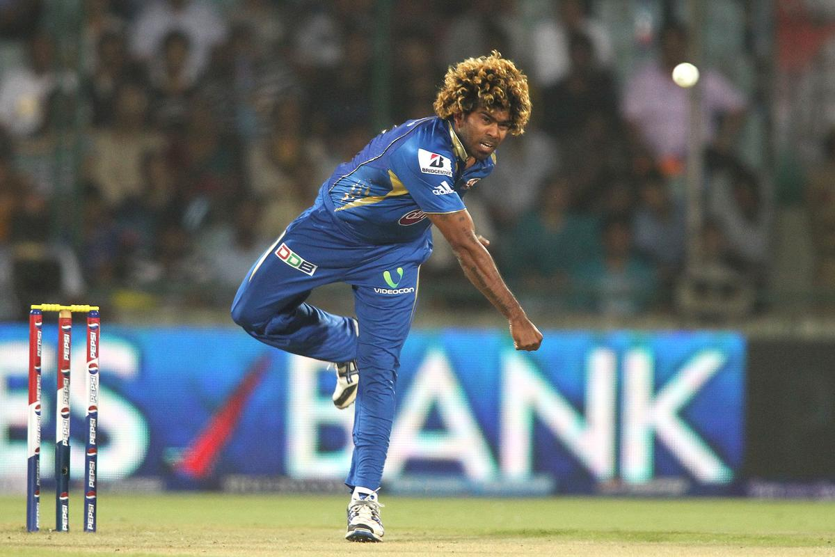 Lasith Malinga of Mumbai Indians sends down a delivery during the qualifier 1 match of the 2013 Pepsi Indian Premier League between The Chennai Superkings and the Mumbai Indians held at the Feroz Shah Kotla Stadium, Delhi on the 21st May 2013..Photo by Shaun Roy-IPL-SPORTZPICS  ..Use of this image is subject to the terms and conditions as outlined by the BCCI. These terms can be found by following this link:..https://ec.yimg.com/ec?url=http%3a%2f%2fwww.sportzpics.co.za%2fimage%2fI0000SoRagM2cIEc&t=1498196269&sig=81q99VDHyCVc1wcmDdEBFA--~C