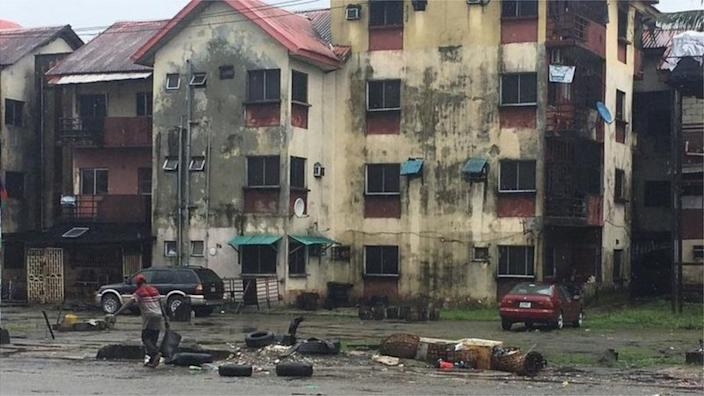 A hotel manager who dumped one of the corpses among the refuse in front of this residential apartment was also charged