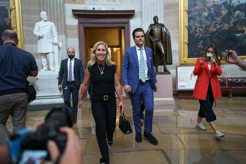 Marjorie Taylor Greene and Matt Gaetz walk through the Rotunda after going to the Senate chamber with other conservatives, to express their opposition to new mask guidance, at the Capitol in Washington, Thursday, 29 July 2021 (AP)