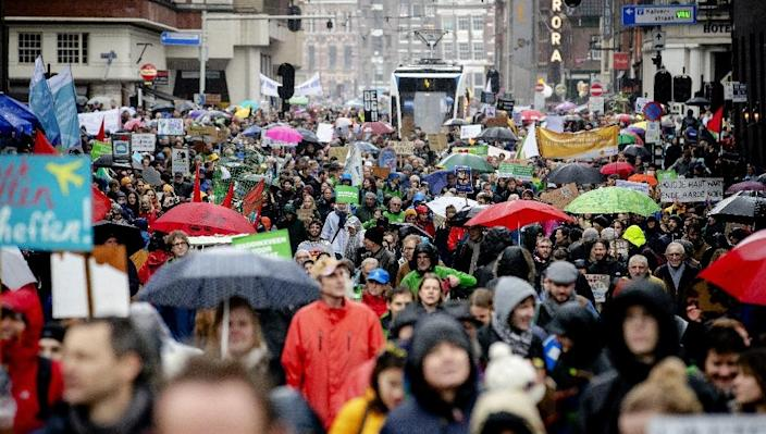Tens of thousands of people turned out for the demonstration in Amsterdam despite the pouring rain (AFP Photo/Robin van Lonkhuijsen)