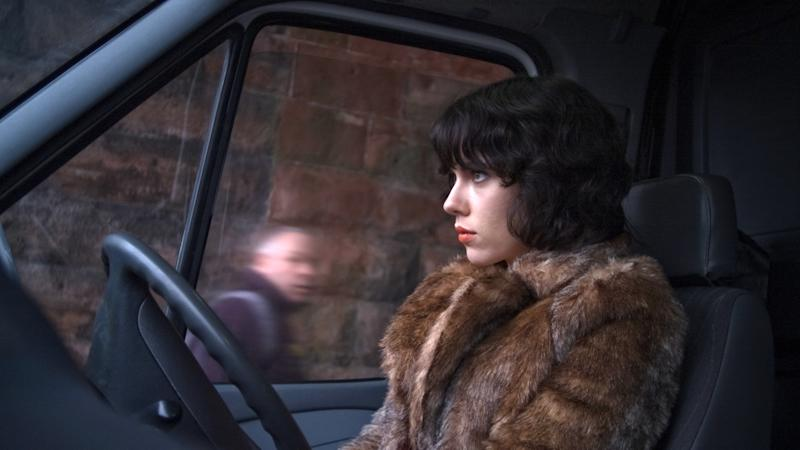 """This image released by A24 Films shows Scarlett Johansson in a scene from """"Under the Skin."""" Sandwiched between the swaggering spectacle of summer and the chest-thumping ambition of awards season, spring moviegoing is usually an afterthought, a limbo for films not bankable enough for July or sufficiently arty-seeming for Oscar. But this season, the movies are alive. (AP Photo/A24 Films)"""