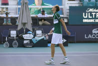 Daniil Medvedev, of Russia, walks gingerly to the net after defeating Alexei Popyrin, of Australia, during the Miami Open tennis tournament, Sunday, March 28, 2021, in Miami Gardens, Fla. (AP Photo/Wilfredo Lee)