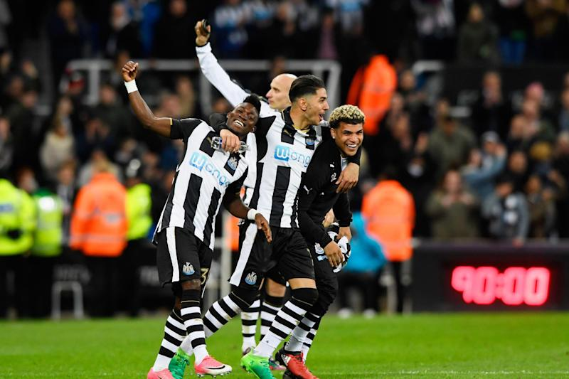 Back in the big time: Newcastle players celebrate their return to the top flight: Getty Images