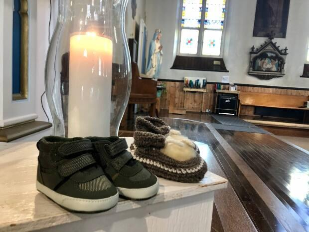 Father John Molina, pastor at St. Simon and St. Jude Church in Tignish, says children's shoes were placed in the church on Friday. (Steve Bruce/CBC - image credit)