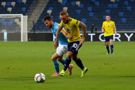 Johnny Russell in action for Scotland (AFP via Getty Images)