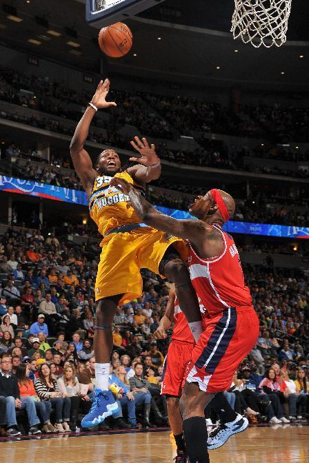 DENVER, CO - MARCH 23: Kenneth Faried #35 of the Denver Nuggets shoots against the Washington Wizards on March 23, 2014 at the Pepsi Center in Denver, Colorado. (Photo by Garrett W. Ellwood/NBAE via Getty Images)