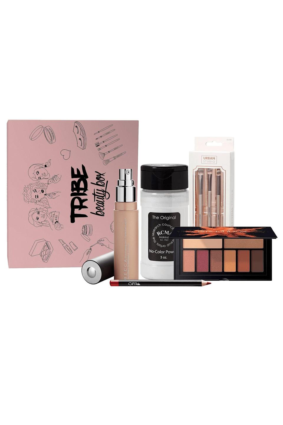 """<p><strong>Tribe Beauty Box</strong></p><p>tribebeautybox.com</p><p><strong>$34.99</strong></p><p><a href=""""https://tribebeautybox.com/collections/tribe-beauty-box-subscription/products/tribe-beauty-box?variant=30108401008674"""" rel=""""nofollow noopener"""" target=""""_blank"""" data-ylk=""""slk:Shop Now"""" class=""""link rapid-noclick-resp"""">Shop Now</a></p><p>With new beauty launches happening every month, it can be hard to keep up. The Tribe beauty box puts together the best beauty products from eyeshadow pallets to lash extensions. The brand is female and <a href=""""https://www.elle.com/fashion/shopping/g33600474/black-owned-handbag-brands/"""" rel=""""nofollow noopener"""" target=""""_blank"""" data-ylk=""""slk:Black-owned"""" class=""""link rapid-noclick-resp"""">Black-owned</a> making it a great place to spend your coin.</p>"""