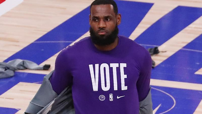 LeBron James, pictured here wearing a 'VOTE' shirt before Game 5 of the NBA Finals.
