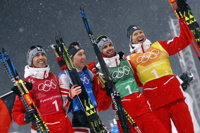 Nordic Combined Events - Pyeongchang 2018 Winter Olympics - Men's Team 4 x 5 km Final - Alpensia Cross-Country Skiing Centre - Pyeongchang, South Korea - February 22, 2018 - Bronze medalists Wilhelm Denifl, Mario Seidl, Lukas Klapfer and Bernhard Gruber celebrate. REUTERS/Kai Pfaffenbach