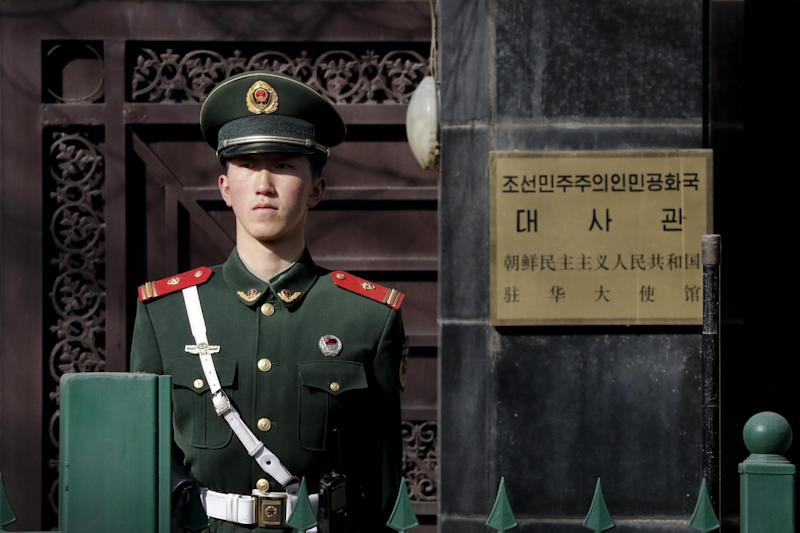 A Chinese paramilitary policeman stands guard outside the North Korea Embassy in Beijing, Tuesday, Feb. 28, 2017. A top North Korean diplomat is visiting Beijing in the wake of China's ban on coal imports from its neighbor and the assassination of North Korean leader Kim Jong Un's older half-brother in Malaysia. (AP Photo/Andy Wong)