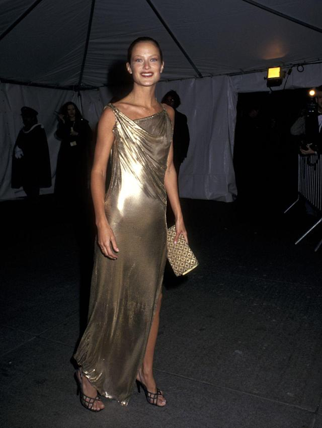 """<p>Following the tragic murder of <a href=""""https://www.crfashionbook.com/celebrity/g26432670/gianni-versaces-secret-moments/"""" rel=""""nofollow noopener"""" target=""""_blank"""" data-ylk=""""slk:Gianni Versace"""" class=""""link rapid-noclick-resp"""">Gianni Versace</a> in 1997, the Met Gala honoured Versace, titling the event """"Gianni Versace."""" Many of his closest friends and muses came together wearing his work to celebrate the designer. American Model Carolyn Murphy wore one of his <a href=""""https://www.crfashionbook.com/fashion/g15336049/gianni-versace-vintage-iconic-dresses/"""" rel=""""nofollow noopener"""" target=""""_blank"""" data-ylk=""""slk:iconic liquified orton fabric dresses"""" class=""""link rapid-noclick-resp"""">iconic liquified orton fabric dresses</a> that defined Versace's style. </p>"""
