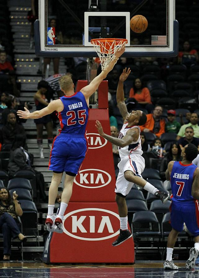 Atlanta Hawks guard Jeff Teague (0) goes up for the shot in the first period against Detroit Pistons forward Kyle Singler (25) in an NBA basketball game against the Atlanta Hawks in Atlanta, Tuesday, April 8, 2014. (AP Photo/Todd Kirkland)